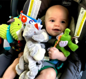 image of a baby with toys